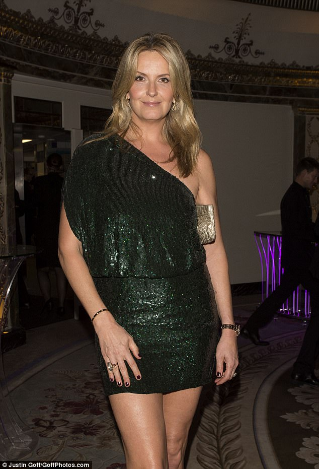 Sensational:Her glittering green dress was embellished with dazzling sequins and cut in an asymmetric shoulder style, while drawing attention to her slim waist with a tight-fitting middle