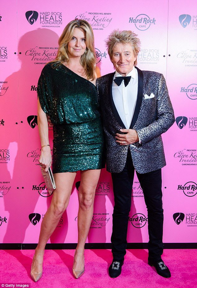 Happy :Penny Lancaster, 46, appeared more loved up than ever with her rocker husband Rod Stewart, 72, as the pair attended the Pinktober Gala with Hard Rock Healsto raise awareness of breast cancer at The Dorchester Hotel on Friday night