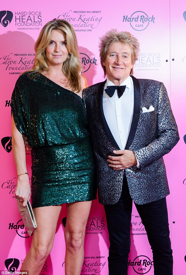 Dress to impress:Rod also dressed to impress in a shiny silver finish suit jacket, which was emblazoned with a leopard print pattern, and layered a crisp white shirt underneath