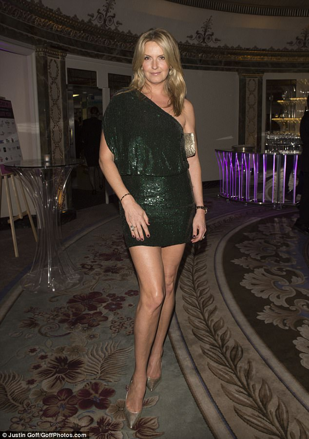 Leggy lady:The former model looked incredible in a thigh-flashing ensemble, which showed off her endless legs in their full glory