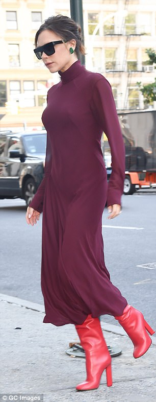 Stunning: The starlet embraced the autumn seasonal colours as she stepped out in a burgundy dress