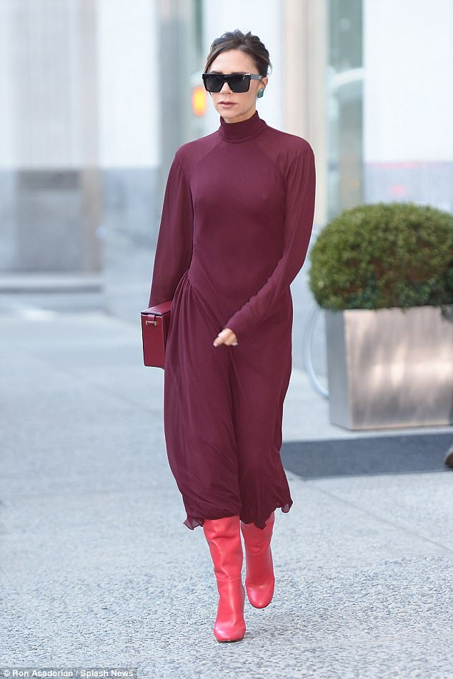 On the run in plum: Earlier in the day Victoria wore a colour clashing ensemble in New York on Friday as she emerged from her hotel