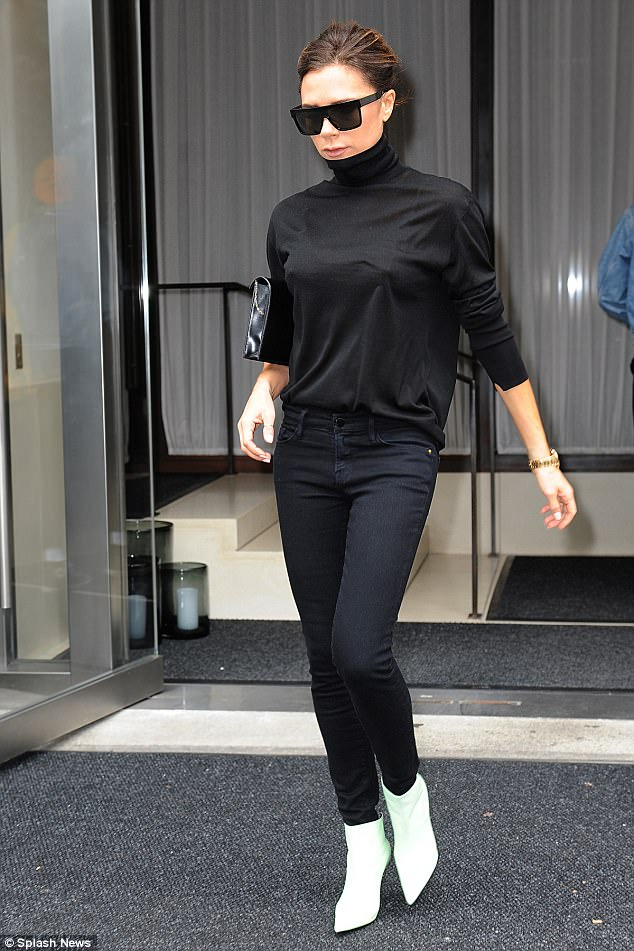 Stylish:Sticking to a chic monochrome look, the mum-of-four completed her look with skintight black jeans and a patent clutch