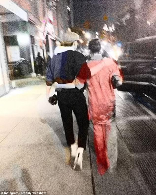 Mother and son: Sharing a sweet snap of the pair wrapping their arms around each other while walking along the street, Victoria wrote on Friday: 'Kisses NYC X x VB'