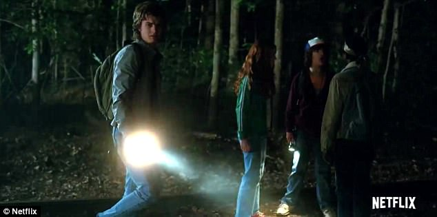 Search party: The gang heads into the forest with a flashlight in hand