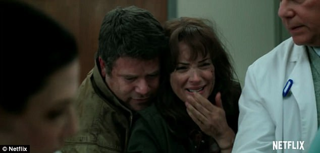 Painful: Watching her son in pain on the hospital bed, Joyce cries as she's comforted by her new love interest, Bob Newby (Sean Astin)