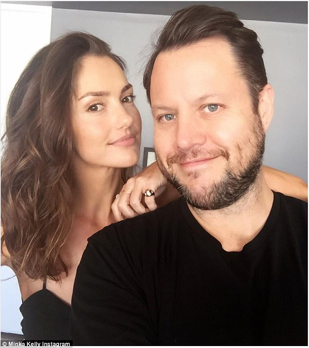 Looking good: The comment and her response was written beneath a photo she posted while posing with her hair stylist Mark Townsend (pictured)