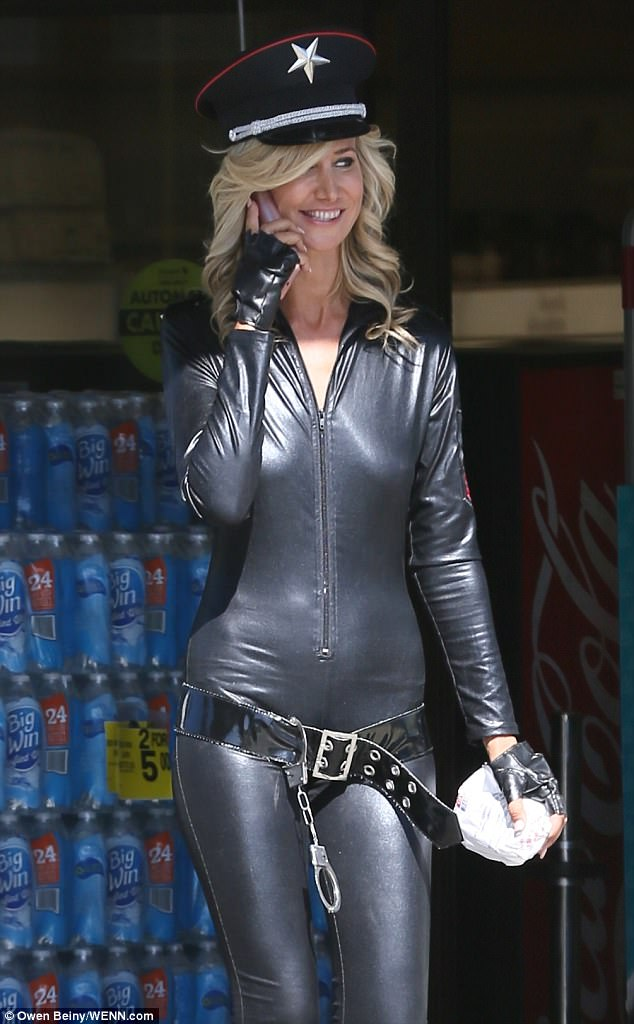 Smile: The blonde looked in great spirits as she chatted on her phone