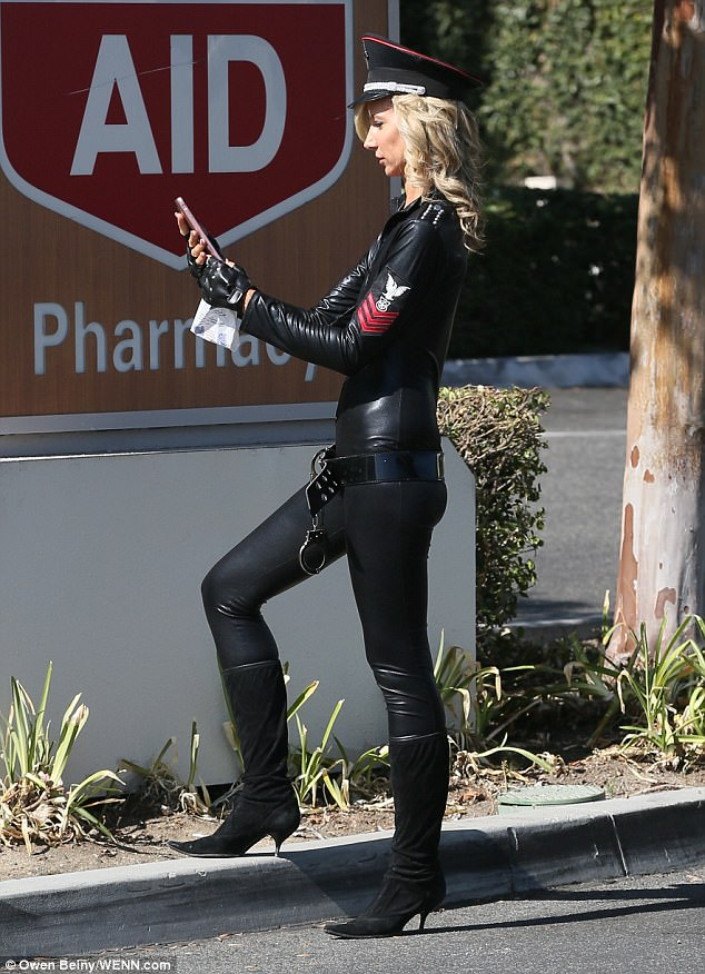 Relax: The star looked relaxed as she headed to a pharmacy before the party