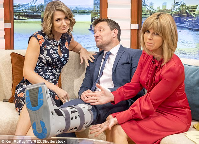 Ouch: Ben Shephard was seen sporting a huge plastic boot on one foot while presenting Good Morning Britain on Friday, as he revealed ankle injury