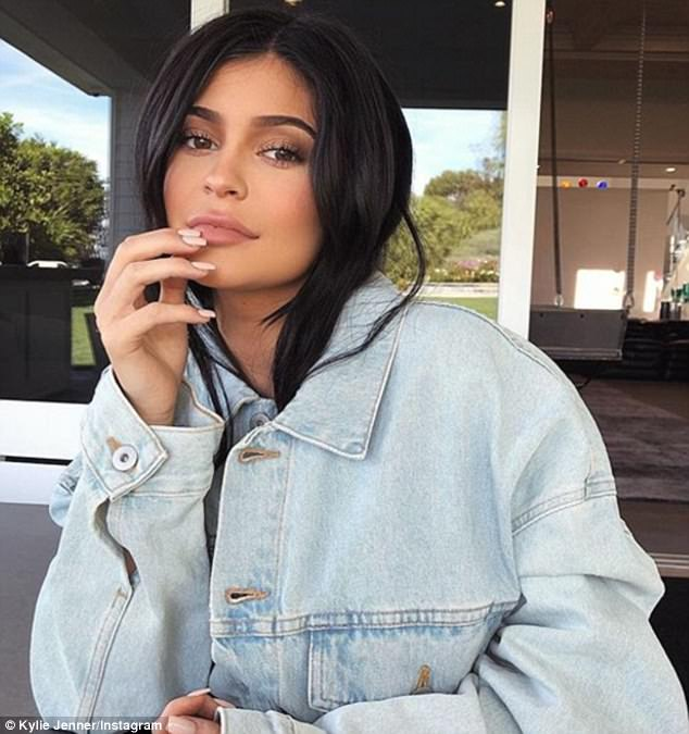 Keeping a low profile: Kylie's (above in a November Instagram) absence left some wondering if the teen will use the images to reveal her long-rumored pregnancy with beau Travis Scott