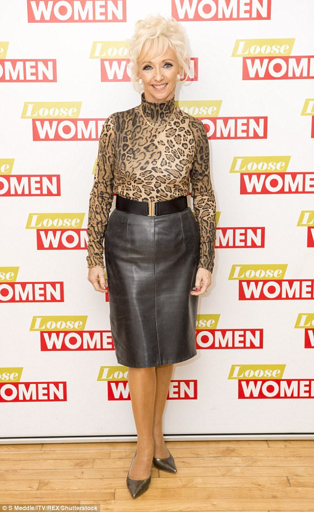 Walk on the wild side: Debbie donned a stylish leopard print blouse and leather skirt, paired with metallic stilettos for her TV appearance
