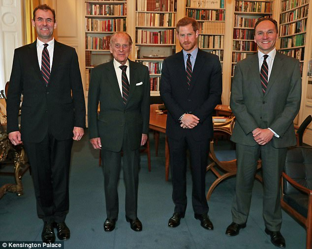 (From left) Major General Robert Magowan, outgoing Commandant General of the Royal Marines; the Duke of Edinburgh; Prince Harry; and Major General Charles Stickland, the incoming Commandant General, pose for a photograph at Buckingham Palace in London today