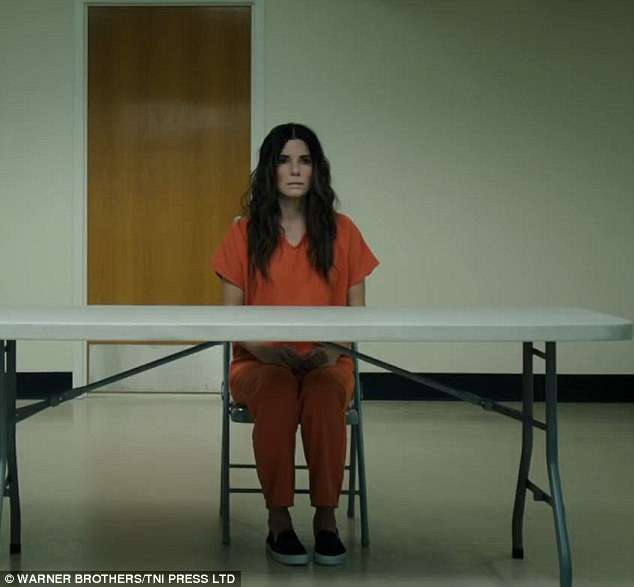Scary:It opens with Sandra's character in an orange prison suit as she sits alone at a table in a bleak-looking room, though her hair and makeup are nicely done