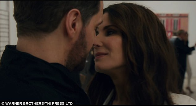 An ex?A man with a scruffy but short beard is seen looking at a diamond and then Sandra is seen getting close to him