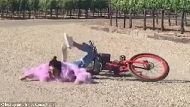 Hilarious: Khloe Kardashian shared a video of her sister Kendall Jenner's comically falling off her bike on Instagram on Tuesday
