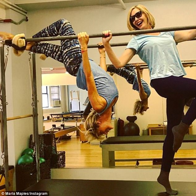 'Kids at heart': Marla, who considers hanging upside down one of her favorite activities, shared this playful photo of her and Melissa in New York City last week