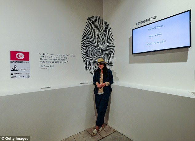 Pictured: Curator Lina is pictured in May at a mock customs check point called #theabsenceofpaths in the Tunisian pavilion in Venice