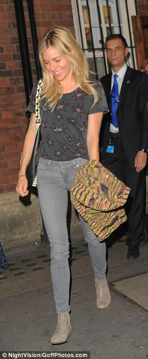 Casual: The star completed her look with a pair of skinny jeans and grey suede boots
