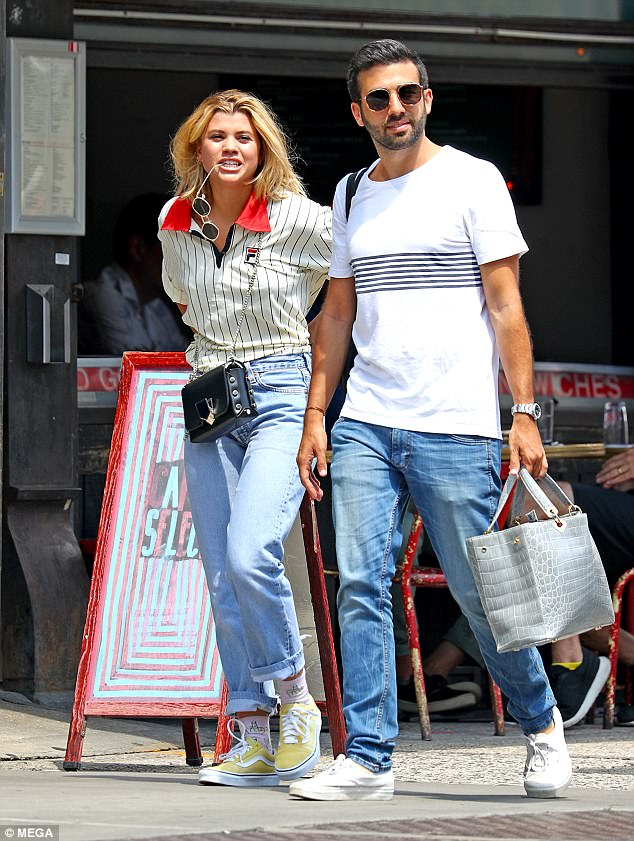 Sporty: The model, 18 - who is the daughter of music legend Lionel Richie, 68 - opted for tomboy chic by pairing a pair of baggy 'mom'-style jeans with an oversized Fila polo shirt
