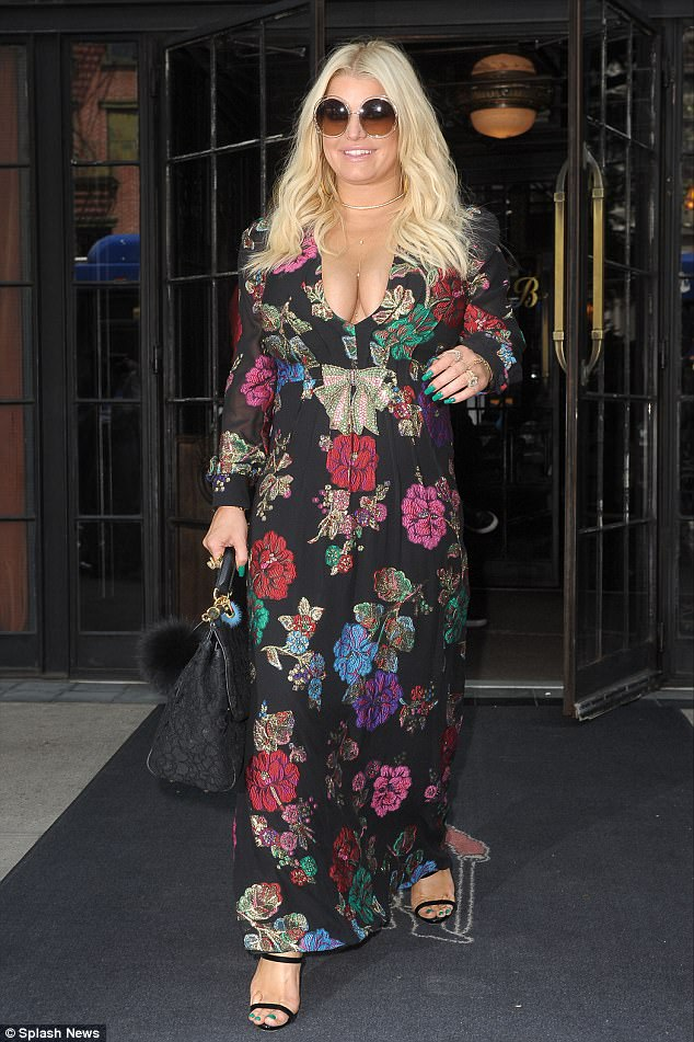 Dare to bare: Jessica Simpson took the plunge once again as she opted for yet another cleavage-baring outfit while out and about in New York City on Thursday