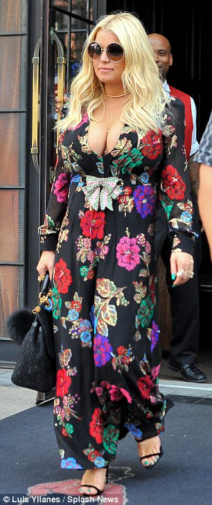 Taking the plunge: The singer, 37, ensured all eyes were well and truly on her in a long-sleeved floral maxi dress featuring a deeply plunging neckline