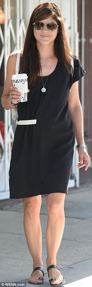 Aglow: The 45-year-old actress had popped on a pair of aviator sunglasses, having slid herself into a knee-length black dress with only one short sleeve