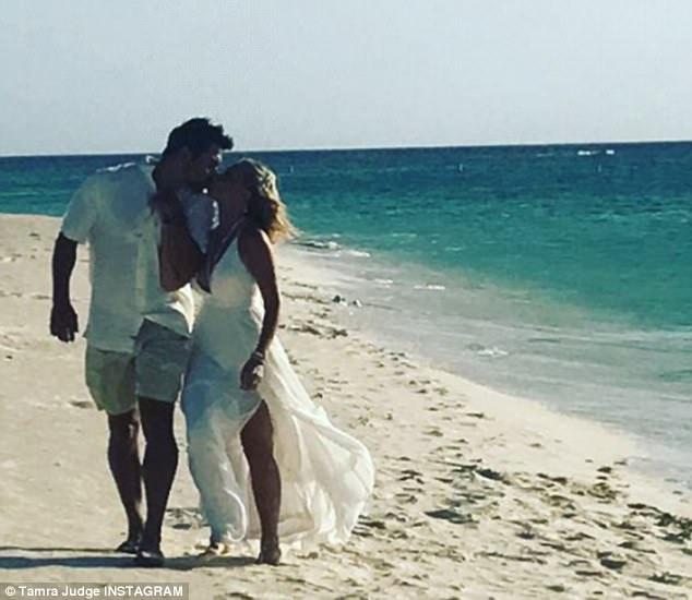 Her rock: The duo appeared over-the-moon in pictures from their Caribbean re-commitment ceremony, writing 'Celebrating love' with the Instagram