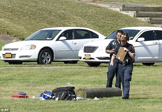 The incident occurred at Sachem East High School (pictured: police at the scene with one of te practice logs) at 8:40am. Coaches were reportedly on the scene and CPR was attempted