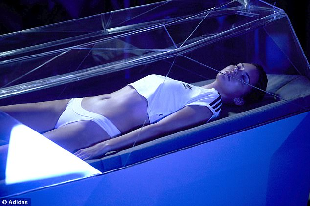 Sensational:The supermodel looks sensational in the edgy advertisement for the sports luxe label as she lays in a glass covered hibernation pod, nodding to a rebirth of the brand with a new generation