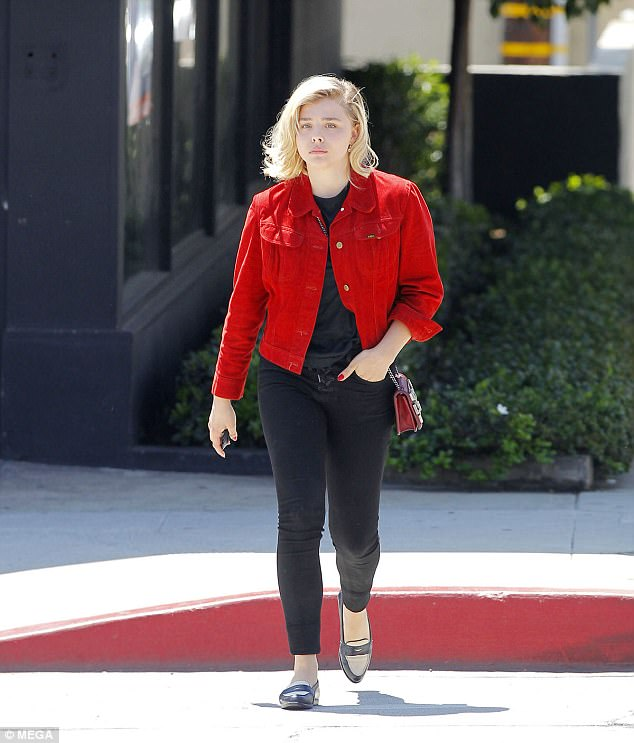 Chic: Donning a red denim biker jacket over a simple black T-shirt, the actress looked sensational
