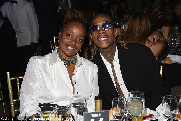 Katie Wimbush-Polk (pictured with son Wiz Khalifa) claims Amber accused her of being an unfit grandmother and blamed her for the death of Wiz's sibling Dorien, who died in February from complications from lymphoma