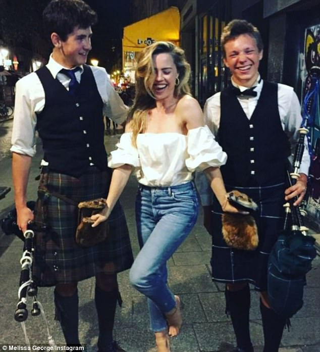 'Happy birthday to me': Melissa George celebrated turning 41 by posting an image of herself smiling gleefully as she posed with her hands in the pockets of bagpipe players