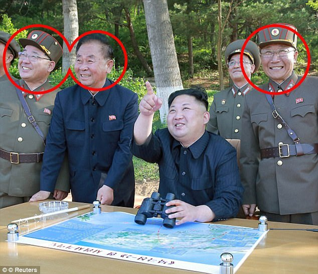 The three men often seen celebrating with North Korean leader Kim Jong-un (centre) are (from left to right) veteran rocket scientist Kim Jong Sik, former air force general Ri Pyong Chol and head of weapons development Jang Chang Ha