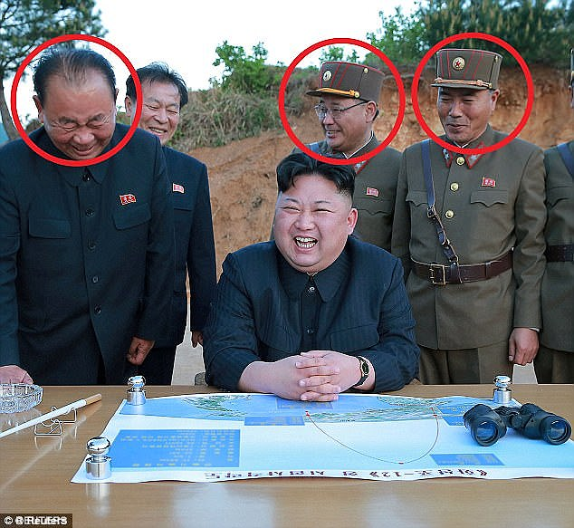The trio is said to be indispensable to North Korea's rapidly developing weapons programme. Pictured from left to right behind dictator Kim: Ri Pyong Chol, Kim Jong Sik and Jang Chang Ha