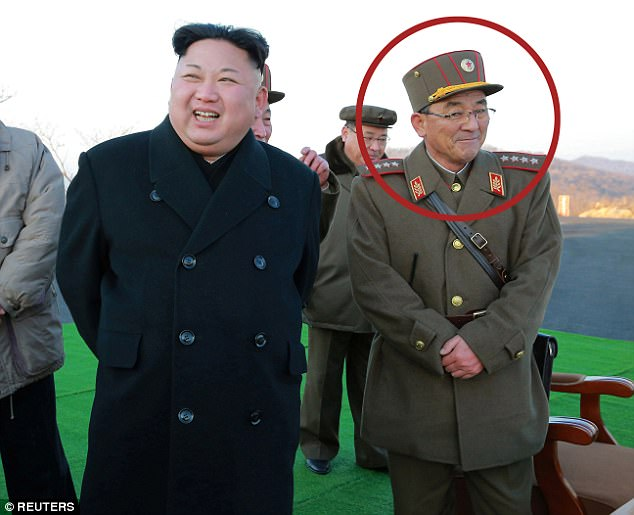 General Kim Rak-gyom (right), head of North Korea's rocket command, is often seen smiling and joking with his subordinates alongside leader Kim Jong-un
