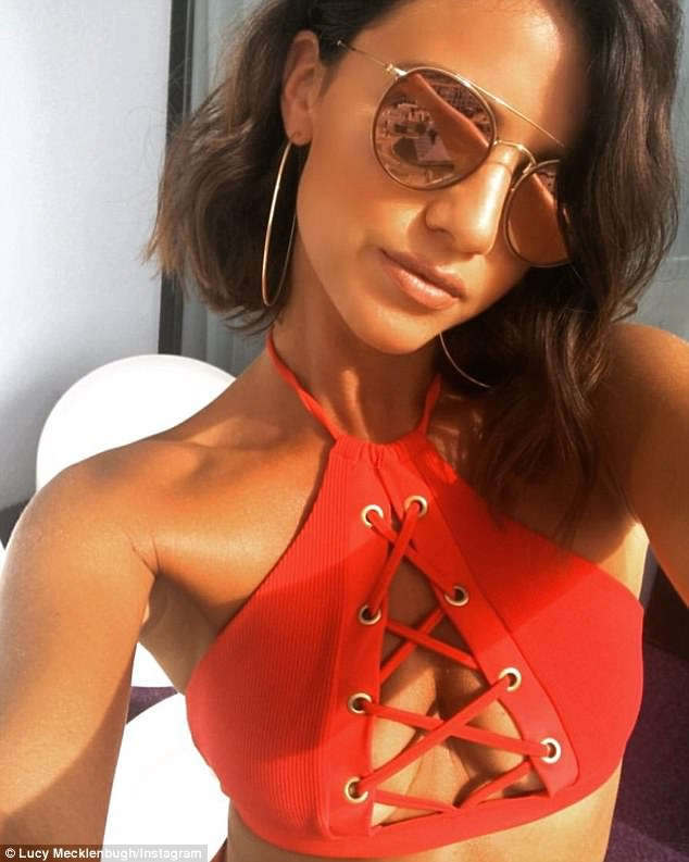 Stunner: Lucy has been sharing some pretty racy snaps of herself in her stunning beach wear on social media and looks incredible