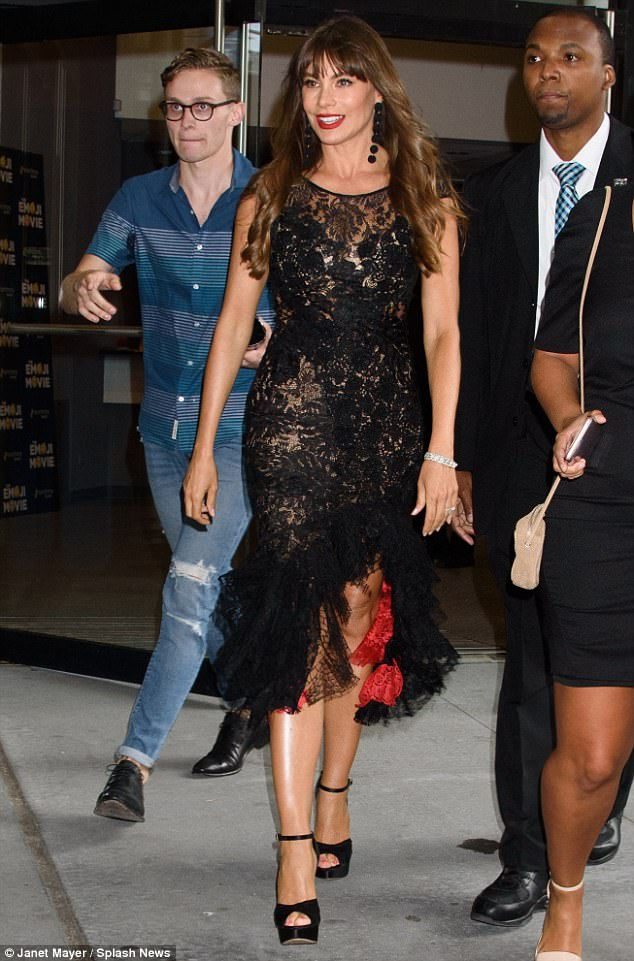 Lovely in LBD: The 45-year-old looked stunning in a short-sleeved black lace dress with a red lining and an asymmetric hemline that started mid-calf and rose to just above her knee