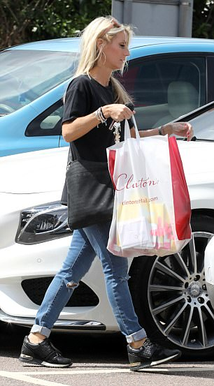 Stress: Keeping her ensemble casual, she teamed a pair of ripped ripped denims with her head-turning slogan tee while she draped a large black cross-body bag around her frame