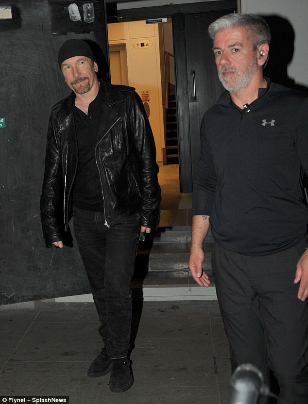 Edgy: The singer donned a shiny black leather jacket and completed the look with a trendy beanie