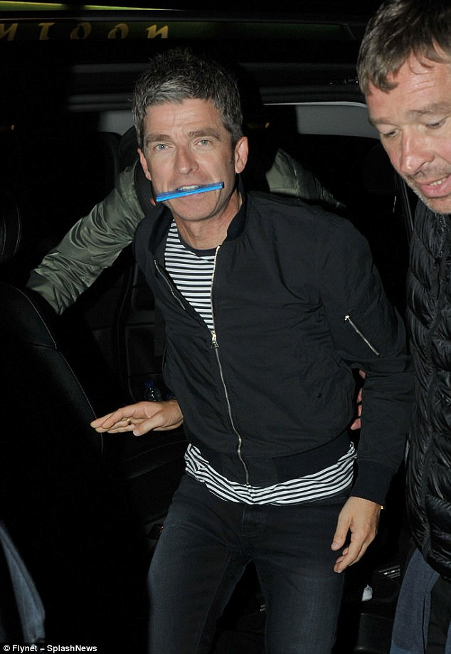 Here he comes! Sarah was joined by her musician husband Noel, 50, who was clearly in high spirits for the bash