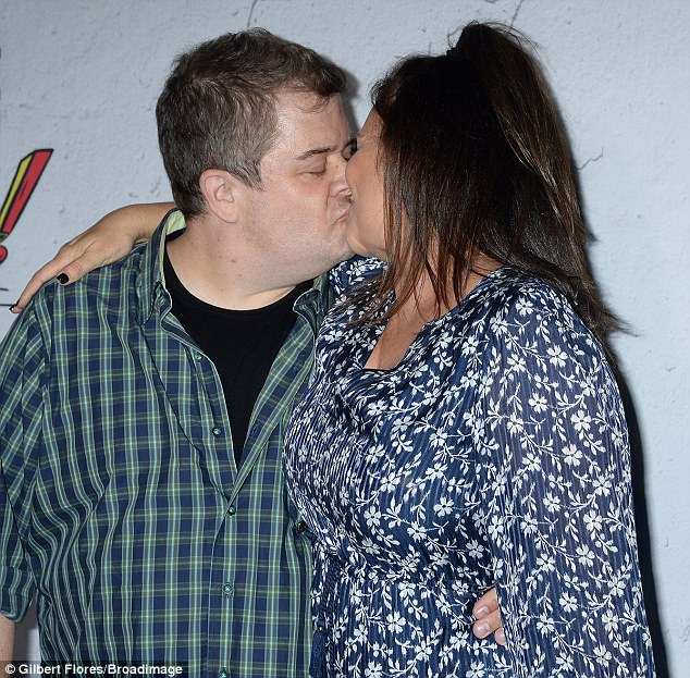 Aww!Patton couldn't have looked any happier as he leaned in to give his bride-to-be some PDA
