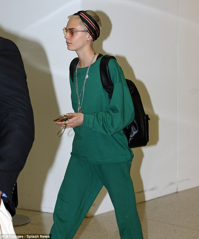 Standing out:The beauty slipped into sweats in a matching hue of green for comfort
