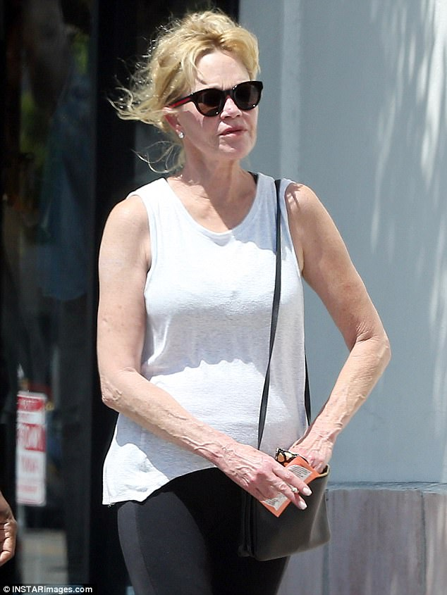 Fit and fantastic: The actress' toned arms were on display in a sleeveless, white blouse that draped loosely over her frame