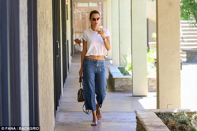 Every walk's a catwalk! The Brazilian-born beauty looked incredible as she strutted along with her taut abs being the centre of attention