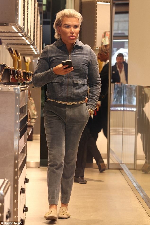 Stepping out:Navigating the streets in his cream loafers, Rodrigo enjoyed a leisurely lunch and a spot of luxury retail therapy while slicking back his much longer 'do off his surgically enhanced face