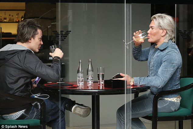 Cheers: Rodrigo seeped on a glass of wine during his lunch catch-up