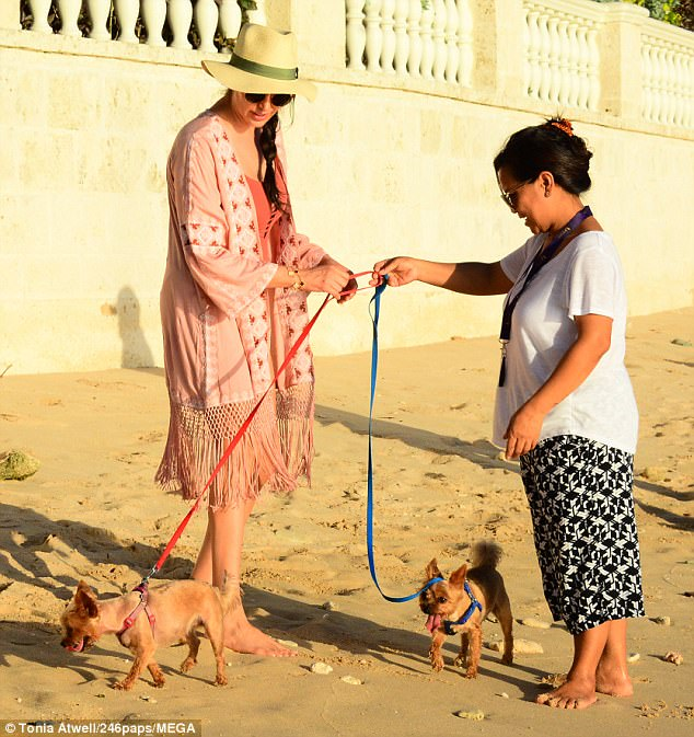 Helping hand: Lauren had the help of an assistant as she took her pet pooches on the most luxurious of dog walks