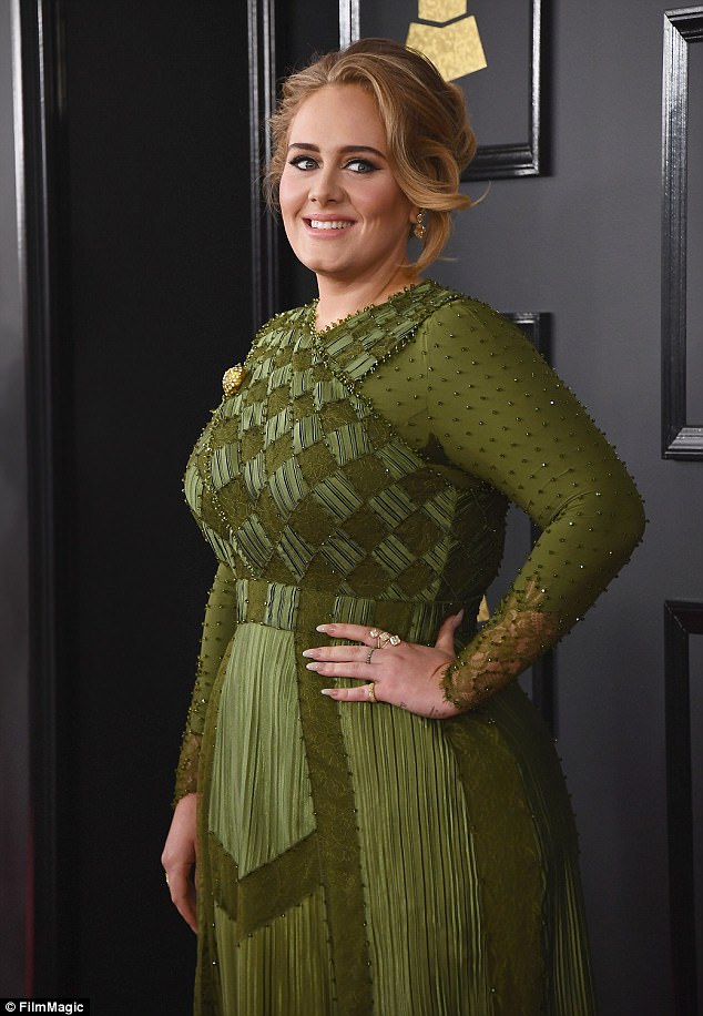 Emerald: In February she was pictured at the 59th Grammy Awards in a classic green number with matching accessories