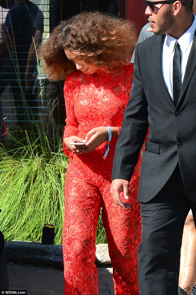 Red hot:Solange Knowles put on yet another sartorial display on Saturday as she made a show-stopping arrival at the Levi's bash for the Coachella Festival